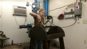 girl staining saddle stand