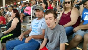 man and boy in grandstands