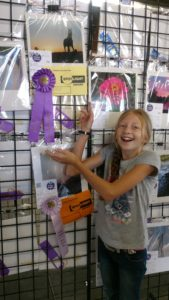 girl with grand champion photo